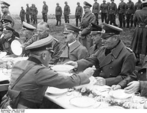 Hitler was given Sudetenland. Here the man of «peace» overlook the «peace agrrement» and Chezh generals surrender