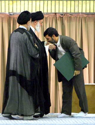A pupet in a string. Mahmoud Ahmadinejad kisses the hand of the supreme leader.