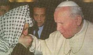 A Muslim and a former terrorist.  It does not matter for the Pope, since he do want to bow down and kiss the idol