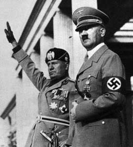 Mussolini and Hitler. Two stern faced man came to the reque of the Pope of Rome.