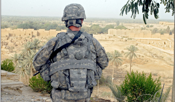 An US soldier overlooking the rebuilding of Babylon in Iraq