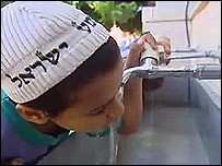 Jewish boy have water in the tap of the school.