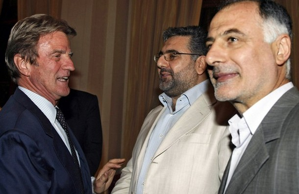 French Foriegn Minister Bernard Kouchner shakes hands with Hezbollah official Nawaf al-Musawi (C) as resigned Hezbollah Minister Mohammed Fniesh stands by (R),