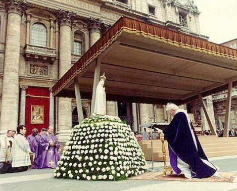 The Pope of Rome bowing down before a statue of the Catholic lady of Fatima