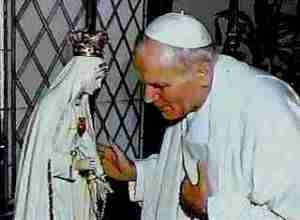 The Pope praying to an idol of stone and wood
