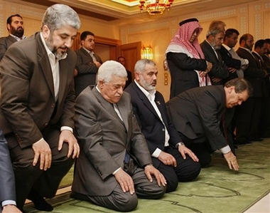Fatah and Hamas leaders praying  together to Allah to help them to destroy Israel.  This picture is taken when the US money was