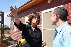 MP speaking to a Jewish settler