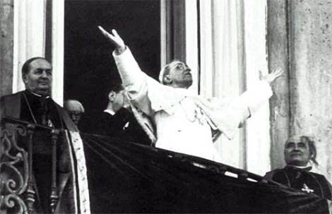 Pope Pius XII faces faithful Catholics inside the Vatican statehood.