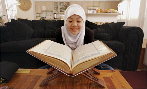 A girl reads the revelation from Muhammad, a black stone worshiper.