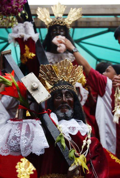 You do not have double vision. There are tow black copies of Jesus in this Catholic parade in Manila.