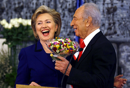 "Flower power. Israeli President Shimon Peres supports Hillary Clintons ""peace talks""."