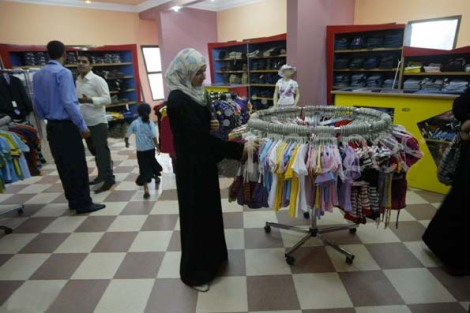 "A Muslim lady visiting a shoppig center in gaza, full of ""aid"" from Israel and United Nations."