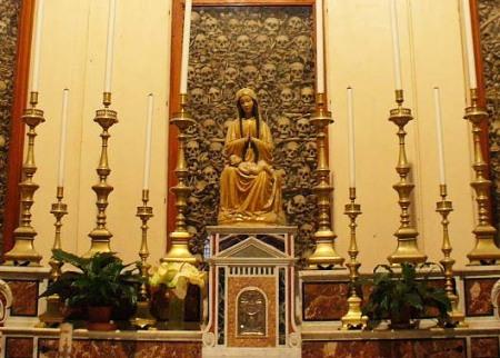 Holy Catholic skulls watch over Madonna and child
