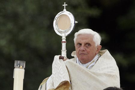 The Pope hold up an image of the sun, and claim Jesus is in the center.