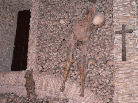 Catholic chapel with rotten man and child hanging from chains