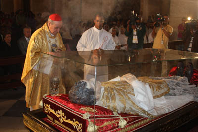 A Papist priest offers inncense to the dead body