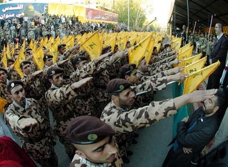 Hizbullah troops give the Nazi salute to their Iranian masters.