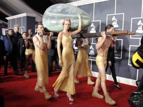 Lady Gaga inside embrionic alien egg, being carried in by aliens.