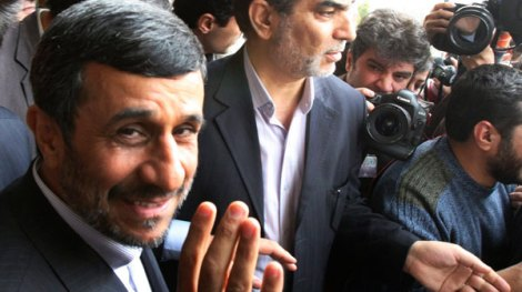 Iranian President Mahmoud Ahmadinejad, waves to the media as he leaves the parliament after he submitted next year's budget bill, in Tehran, Iran, Sunday, Feb. 20, 2011
