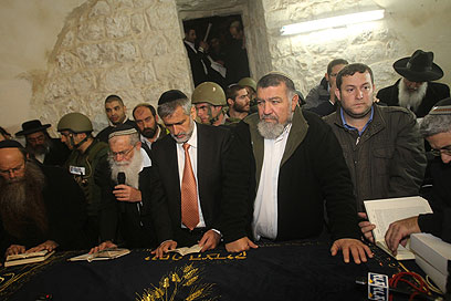 Interior Minister Eli Yishai pray at the tomb of Joseph in Nablus in Samaria.