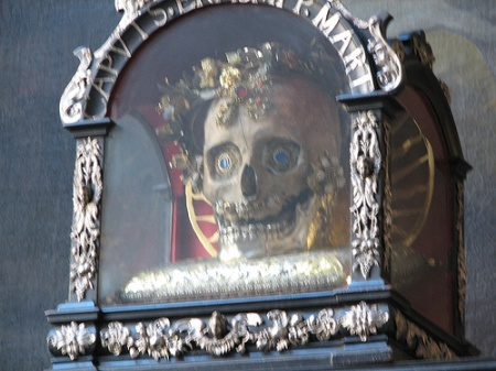 The skull of Saint Mendita is placed on the wall of St. Peter's Church in Munich.