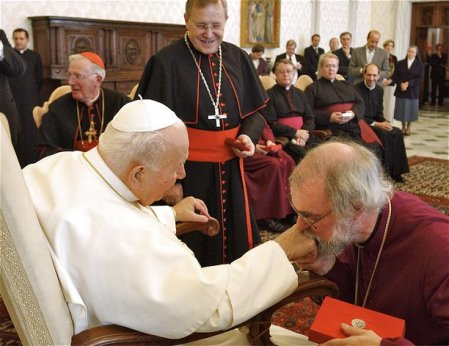 The Archbishop of Cantebury bow and kiss the ring on the finger of the late Pope.