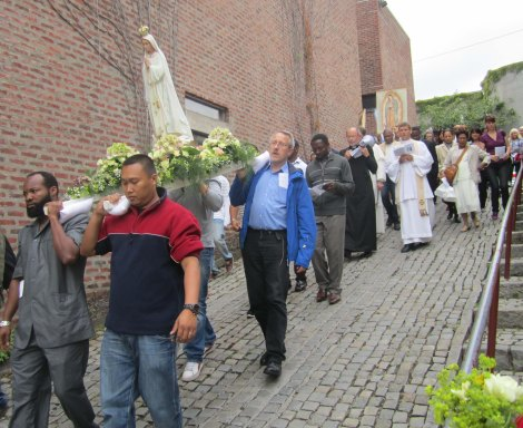 "The ""Queen of Heaven"" is carried on the shoulders of Catholics outside St. Halvards Chuch in Oslo in Norway."