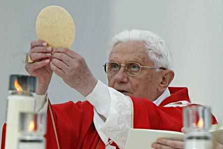"The wafer ""Jesus"" and the replacement of the Holy Spirit, the Pope, is presented as God's infallible perfection on Earth."