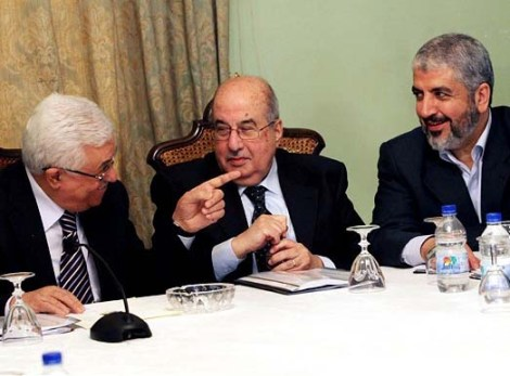 Palestinian President Mahmoud Abbas, left to right, Salim al-Zanoun, head of Palestinian national council and Hamas' supreme leader, Khaled Mashaal attend a meeting in Cairo