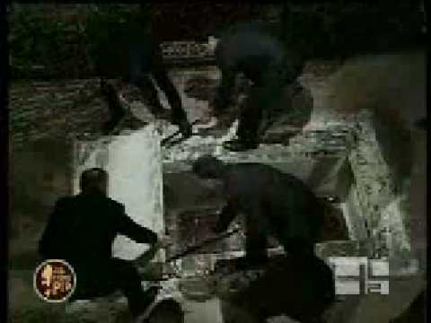 Roman Catholic grave looters at work, removing the coffin of Padre Pio.