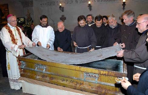 A Vatican approved Bishop helps the clergy men and friars to open the coffin of Padre Pio.