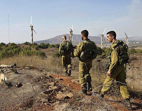 Israeli army on patrol on the Golan secures peace in the Galilee.