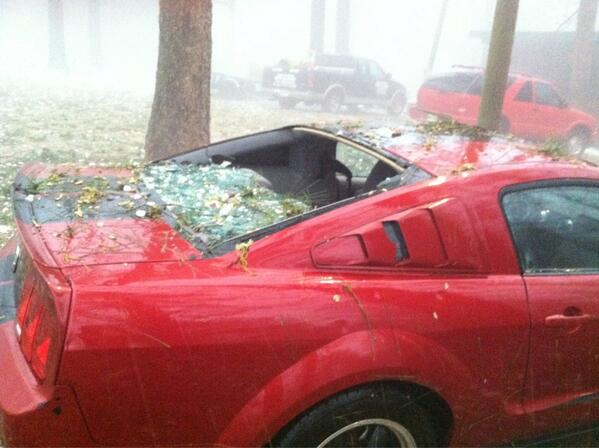 This car was hit by hails that was larger than golf balls. Some even bigger than that.