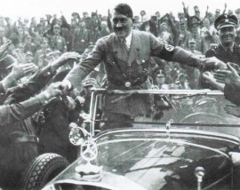 Anschluss: Hitler was greeted as an Holy Roman emperor in Austria on 12 March 1938.