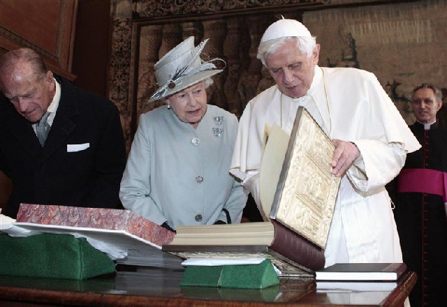 The Catholic Church now has two Popes. One who flattered the Queen of England, and one who offends her.