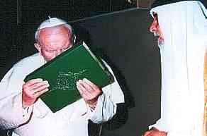 The late Pope kisses the Koran.