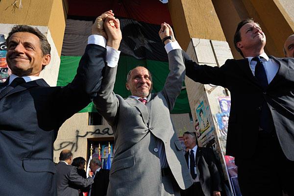 "Nicolas Sarkhozy and Mustafa Abdul Jalil join David Cameron in Tripoly, rejoicing with everyone who shouts ""allah U Akbar""."