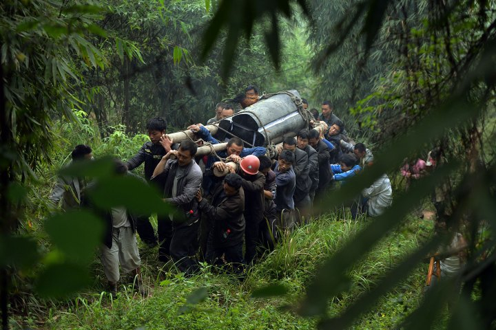Villagers carry the coffin of a man killed after a magnitude 7.0 earthquake hit Lushan, Sichuan Province on April 22, 2013.