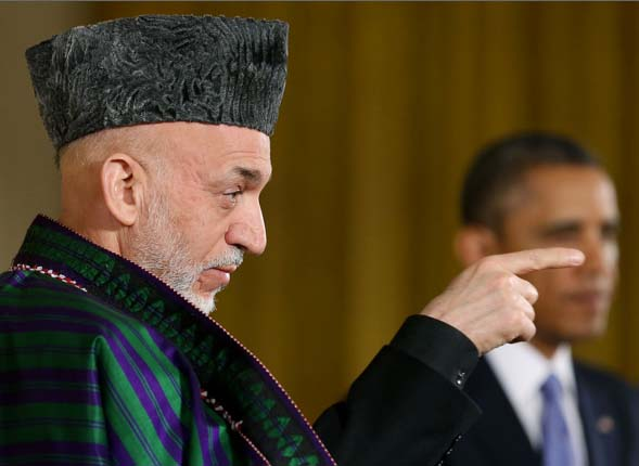 The Afghan President to not take credit cards, but desired to see the green bucks being brought inside his cabin in suitcases.