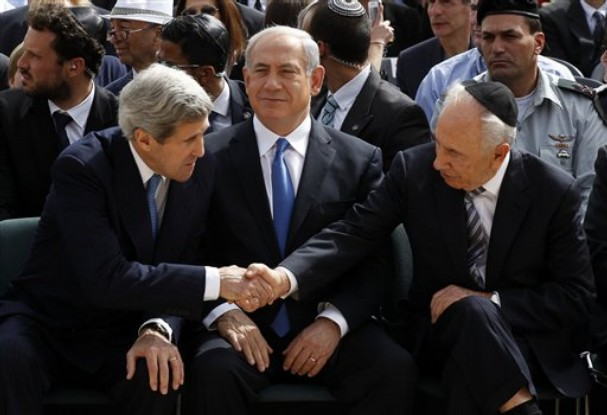 John Kerry shakes hands with Israeli President Shimon Peres.