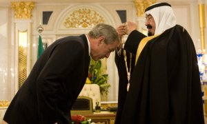 George W. Bush bowing before the Saudi King.