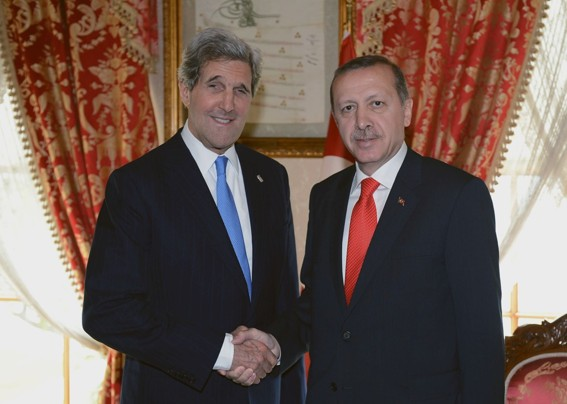 John Kerry at least managed to get up in time to shake hands with the PM of Turkey.