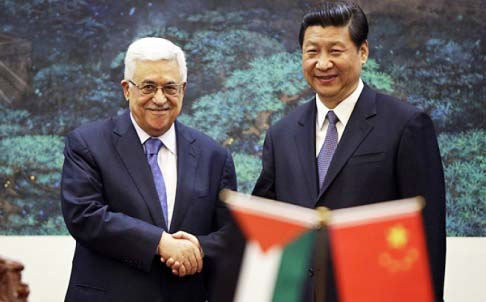Mahmoud Abbas got a royal welcome in China, greeted by President Ix.