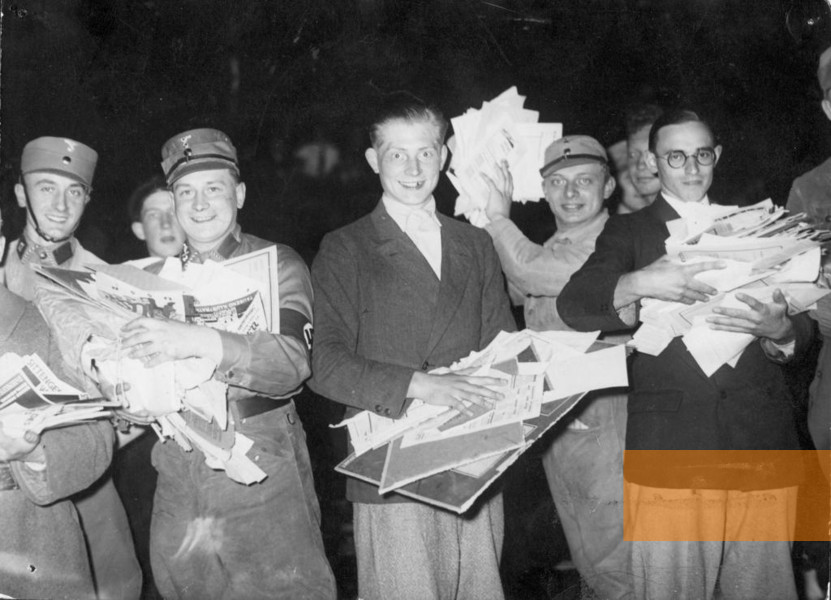 Germany students and  Nazi cadres collect Jewish booklets to be burnt in Berlin.