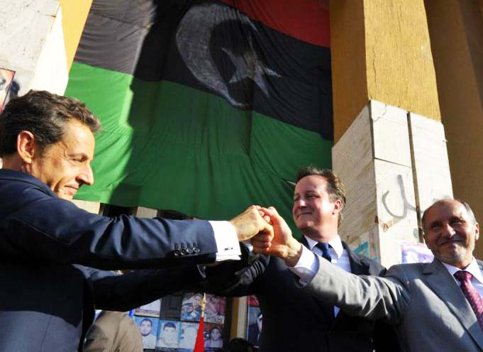 David Cameron and Nicolas Sarkozy fighting hard to spread radical Islam in North Africa . Here the party is on in Tripoli.