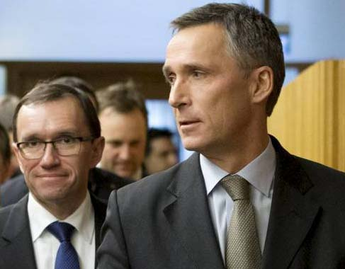 Norwegian PM Stoltenberg followed by defense minister Barth Eide.