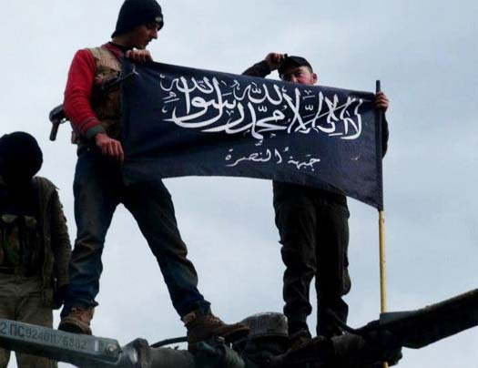 A flag supported by Washington is hoisted inside Syria.