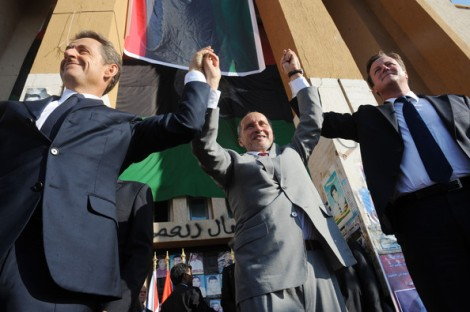"French President Nicolas Sarkozy, leader of Libya's interim government Mustafa Abdul-Jalil and Prime Minister David Cameron celebrate victory for ""allah""."