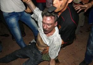 A dying Ambassador Christopher Stevens carried around like a dog in Bengazi.