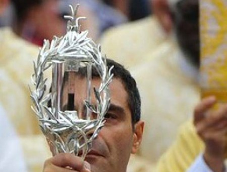 "The wafer-Jesus has been replaced with the ""holy blood"" of the Pope, to be worshiped."
